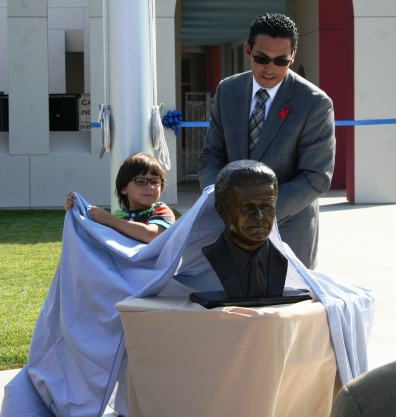 Enrique E. Camarena and son unveil bust of his father, whose name now graces the District's newest school.